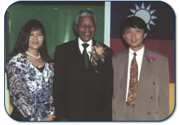 Former South African President, Mr. Nelson Mandela with Hung-Jen Yuan and his wife Yi-Mei